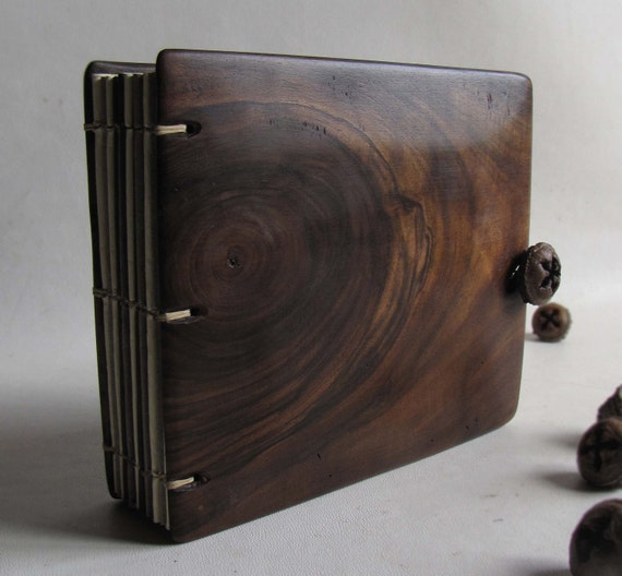 Walnut album with  wooden covers  and seed fastener.