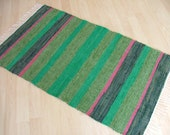 MOSSY GLEN -- Hand-woven green rug with black and pink stripes