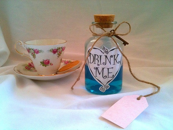 Alice In Wonderland Drink Me Bottle Tattoo