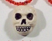 Red Bead Skull Necklace.