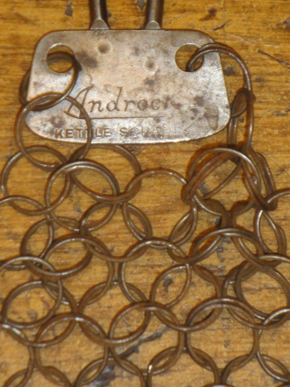 Vintage metal pot scrubber marked androck kettle scraper