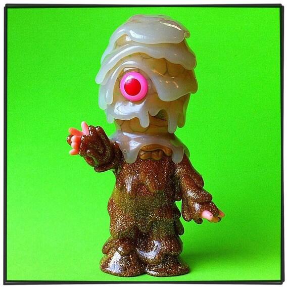 Bukken (gold sparkle body with GID head)...  Kaiju Melt Monster vinyl toy with Glow In The Dark head...