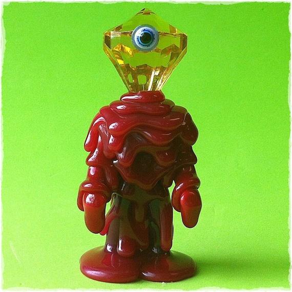 Im the Little Guy.  (crystal head cyclops)...  Glow in the Dark Kaiju Melt Monster vinyl toy...