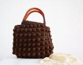 vintage. chocolate brown. knit. sweater. bag. purse. marble plastic  handles.