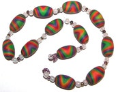 12 polymer clay oval beads with extras - Rainbow Whirl - Hand Crafted