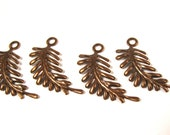 Vintaj Natural Brass Fern Curving Left Fastenable - 4 pieces