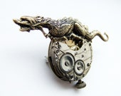 Racing steampunk dragon brooch