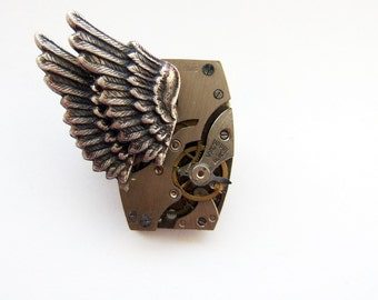 Steampunk winged watch movement brooch