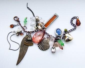 Glitz and glam, bold and brassy charm bracelet