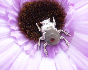 big flower and clockwork bug hair clip