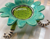 colorful soap dish with kooky striped legs