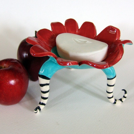 whimsical ceramic dish w/ curly striped legs