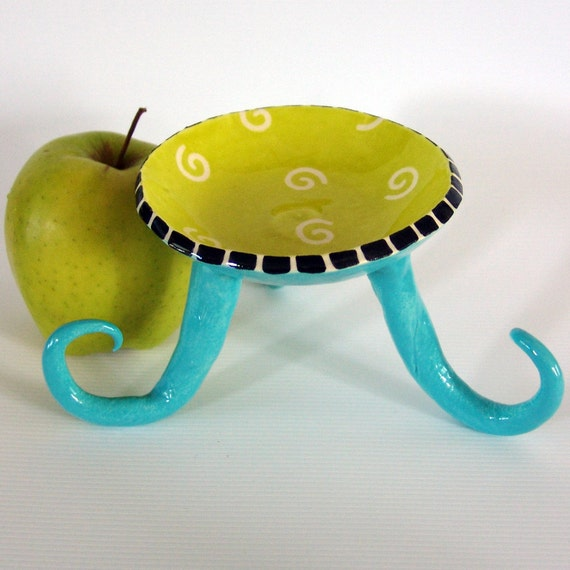 whimsical ceramic candle dish with curly legs