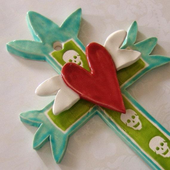ceramic cross with winged heart & skulls