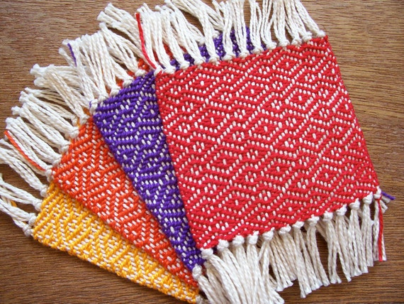 handwoven coaster set in summer orange, yellow, red and purple, set of four
