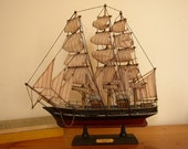 Vintage Model Ship with Anchor and Striped Sails