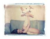 4x5 angelic polaroid transfer of girl with toy plane in 8x10 mat- signed by artist