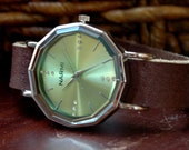 Light green watch face on brown leather band Unisex wrist watch