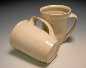 two white styrostyle ceramic coffee cups