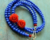 Frida necklace in kings blue glass and orange roses- sterling silver