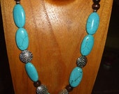 Turquoise, Brown and Silver Necklace With Carved Heart Focal Bead