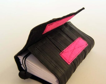 Recycled journal, bike inner tube, blank pages, black linen and neon pink velcro closure, small.
