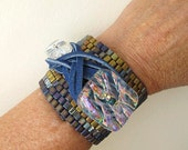 Golden Rule Chunky Brick by Brick cuff bracelet. Purple, gold, iridescent crystal and blues with interchangeable leather tie