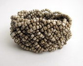 Chunky Clunky Braided beads cuff bangle bracelet. Beige, sand, neutrals.  Elastic. One size fits all.