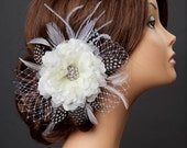 Beautiful handcrafted hair flower in ivory with French netting, feathers, crystal center