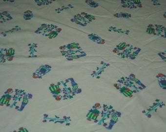 vintage 70s novelty juvenile print fabric, featuring dutch boy and girl design, 1 yard