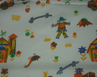 vintage 70s farmyard novelty print fabric, featuring plaid barn and flowers design, 26 inches long