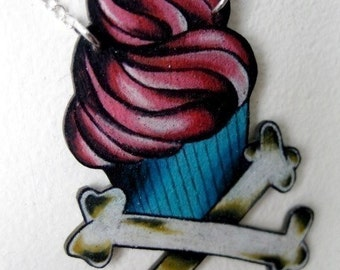 tattoo style cupcake and crossbones necklace bright hot pink and blue