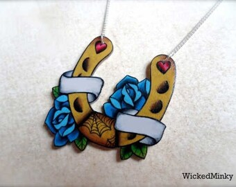 tattoo horseshoe and blue roses necklace