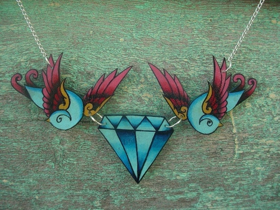 Tattoo new school pink and blue swallow holding vintage faux diamond necklace chest piece tattoo by WickedMinky