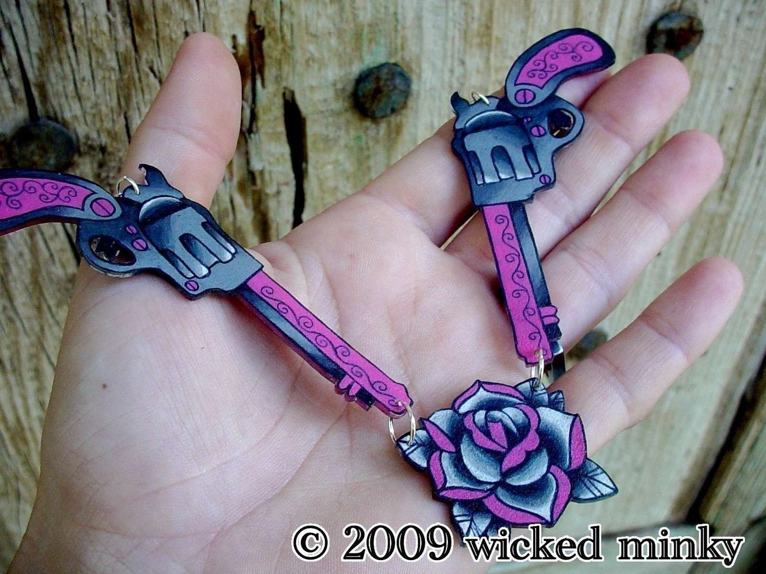 Hot pink and black double vintage tattoo pistol and rose for Pink gun tattoo