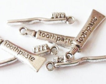 10, 5 Toothpaste and 5 Toothbrush Charms