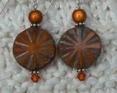 Pumkin star earrings by beads of folly