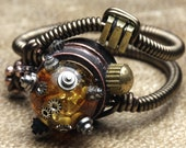 Steampunk Jewelry - RING  - RELIC OOAK - Cosplay ring with Clock Part inlayed in MYSTERIOUS Amber - This piece was displayed at the Museum of the History of Science Oxford UK - 11 ONLY