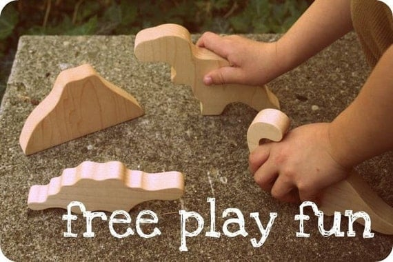 Dinosaur teething and playing Maple Wood pretend toy set