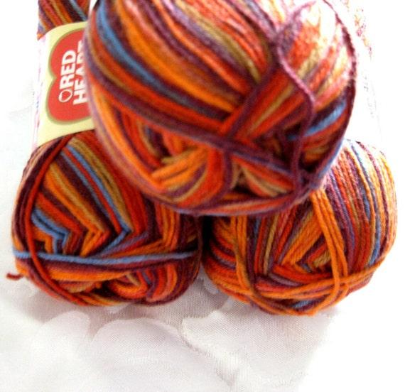 Superwash wool self striping Sock yarn, Tequila Sunrise, orange, brown, blues, Heart & Sole