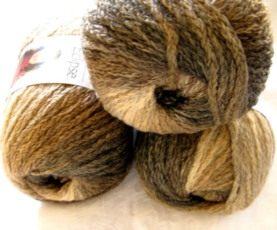 Wool blend yarn,  subtle striping pattern of reds, browns, Boutique Eclipse Trail