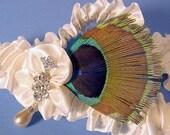 reserve listing for rw0825 set color change wedding garter UNE FLEUR CRYSTALLINE in white with peacock wedding garter