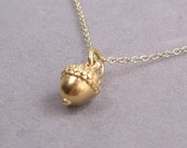 tiny gold acorn charm necklace by rockedjewelry