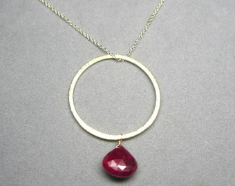 ruby necklace with gold hoop pendant by rockedjewelry