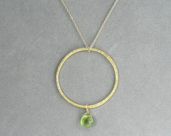 necklace with brushed gold hoop and peridot pendant by rockedjewelry