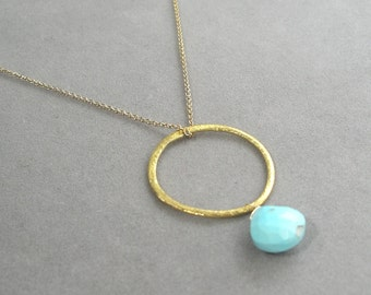 necklace with sleeping beauty turquoise on gold ring pendant by rockedjewelry