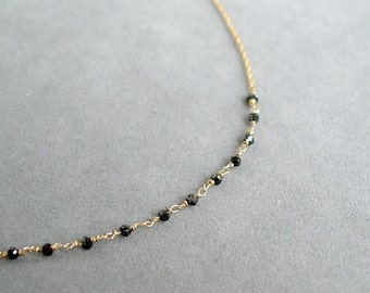 diamond bead necklace with black diamonds in gold