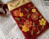 red embroidered pouch bag