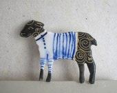 Black sheep wearing Breton Stripes - Handformed and Handpainted Porcelain Brooch