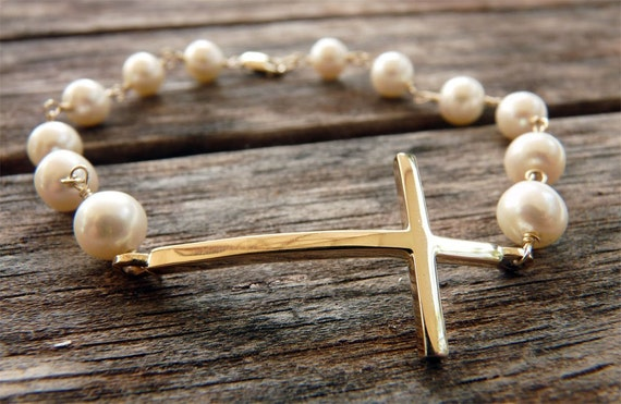 14 karat yellow gold cross bracelet on saltwater Akoya cultured pearls